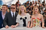 "(FromL) US actor Karl Glusman, Danish director Nicolas Winding Refn, US actress Elle Fanning and Australian actress Bella Heathcote pose on May 20, 2016 during a photocall for the film ""The Neon Demon"" at the 69th Cannes Film Festival in Cannes, southern France.  / AFP / LOIC VENANCE"