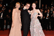 """Director Nicolas Winding Refn (C) and Liv Corixen (L) and actress Elle Fanning (R) attend """"The Neon Demon"""" Premiere during the 69th annual Cannes Film Festival at the Palais des Festivals on May 20, 2016 in Cannes, France."""