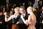 "Danish director Nicolas Winding Refn (C) poses with his wife Liv Corfixen (L) and US actress Elle Fanning as they arrive on May 20, 2016 for the screening of the film ""The Neon Demon"" at the 69th Cannes Film Festival in Cannes, southern France.  / AFP / Valery HACHE"