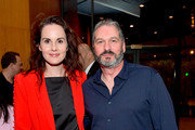 "Actress Michelle Dockery and Creator/Writer/Director/Executive Producer Scott Frank attend Netflix Celebrates 12 Emmy Nominations For ""Godless"" at DGA Theater on August 9, 2018 in Los Angeles, California."