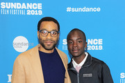 "Director, actor, and writer Chiwetel Ejiofor (L) and actor Maxwell Simba attend the Netflix film ""The Boy Who Harnessed The Wind"" Sundance Film Festival Park City screening at The Ray Theatre on January 26, 2019 in Park City, Utah."