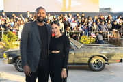 "Metta World Peace (L) and Maya Ford attend the World Premiere of  ""El Camino: A Breaking Bad Movie"" at the Regency Village on October 07, 2019 in Los Angeles, California."