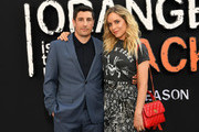 """Jason Biggs and Jenny Mollen attend the Netflix's """"Orange is the New Black"""" Season 7 Premiere on July 25, 2019 in New York City."""
