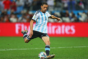 Maxi Rodriguez of Argentina shoots and scores his penalty kick in a shootout to defeat the Netherlands during the 2014 FIFA World Cup Brazil Semi Final match between the Netherlands and Argentina at Arena de Sao Paulo on July 9, 2014 in Sao Paulo, Brazil.