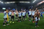 Argentina celebrate after defeating the Netherlands in a penalty shootout during the 2014 FIFA World Cup Brazil Semi Final match between the Netherlands and Argentina at Arena de Sao Paulo on July 9, 2014 in Sao Paulo, Brazil.