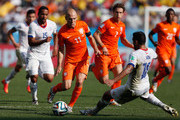 Arjen Robben of the Netherlands controls the ball as Gonzalo Jara of Chile gives chase during the 2014 FIFA World Cup Brazil Group B match between the Netherlands and Chile at Arena de Sao Paulo on June 23, 2014 in Sao Paulo, Brazil.