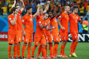 (L-R) Daley Blind, Stefan de Vrij, Klaas-Jan Huntelaar, Wesley Sneijder, Dirk Kuyt, Jeremain Lens, Georginio Wijnaldum, Ron Vlaar and Robin van Persie of the Netherlands celebrate after a made penalty kick in a shootout during the 2014 FIFA World Cup Brazil Quarter Final match between the Netherlands and Costa Rica at Arena Fonte Nova on July 5, 2014 in Salvador, Brazil.