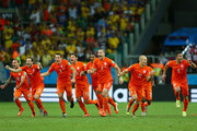 Wesley Sneijder, Daley Blind, Stefan de Vrij, Klaas-Jan Huntelaar, Jeremain Lens, Ron Vlaar; Arjen Robben and Robin van Persie  of the Netherlands celebrate victory in a penalty shootout against Costa Rica during the 2014 FIFA World Cup Brazil Quarter Final match between the Netherlands and Costa Rica at Arena Fonte Nova on July 5, 2014 in Salvador, Brazil.