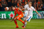 Robin van Persie of the Netherlands holds off Vaclav Prochazka of the Czech Republic as scores their second goal and his 50th in international matches during the UEFA EURO 2016 qualifying Group A match between the Netherlands and the Czech Republic at Amsterdam Arena on October 13, 2015 in Amsterdam, Netherlands.