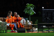 Wesley Sneijder of the Netherlands watches TV with his family on the pitch, during a presentation marking his last ever game for the Netherlands after the International Friendly match between Netherlands and Peru at Johan Cruyff Arena on September 6, 2018 in Amsterdam, Netherlands.