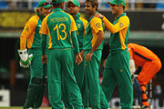 Imran Tahir of South Africa is congratulated by team mates, after he bowled Mudassar Bukhari  of the Netherlands during the 2011 ICC World Cup Group B match between Netherlands and South Africa at Punjab Cricket Association Stadium on March 3, 2011 in Mohali, India.