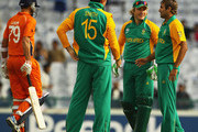 Imran Tahir of South Africa is congratulated by team mates, after he bowled Bernard Loots of the Netherlands for LBW during the 2011 ICC World Cup Group B match between Netherlands and South Africa at Punjab Cricket Association Stadium on March 3, 2011 in Mohali, India.
