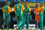 Imran Tahir of South Africa is congratulated by team mates, after he bowled Berend Westdijk of the Netherlands for LBW during the 2011 ICC World Cup Group B match between Netherlands and South Africa at Punjab Cricket Association Stadium on March 3, 2011 in Mohali, India.