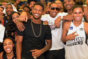 Usher, Ludacris and  Laura Govan Basketball Wives of LA during Neuro Drinks At LudaDay Weekend Celebrity Basketball Game at GSU Sports Arena on September 1, 2013 in Atlanta, Georgia.