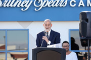 Nevada Childhood Cancer Foundation President and CEO Jeff Gordon (L) speaks as talent manager Larry Rudolph looks on during the grand opening of the Nevada Childhood Cancer Foundation Britney Spears Campus on November 4, 2017 in Las Vegas, Nevada.