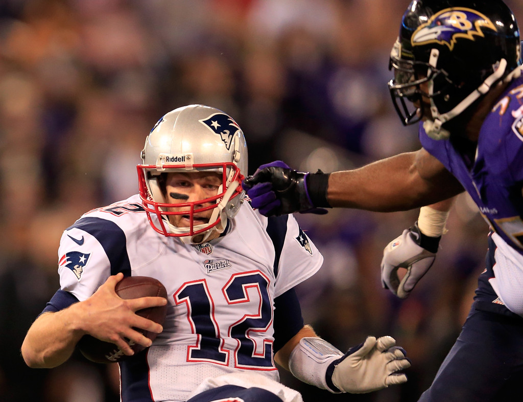 Tom Brady and Terrell Suggs s s New England Patriots v