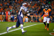 Tight end Dwayne Allen #83 of the New England Patriots scores a second quarter touchdown against the Denver Broncos at Sports Authority Field at Mile High on November 12, 2017 in Denver, Colorado.