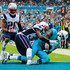 DeVante Parker Logan Ryan Photos - DeVante Parker #11 of the Miami Dolphins scores a touchdown as he is tackled by Devin McCourty #32 of the New England Patriots during the second quarter of the game at Sun Life Stadium on January 3, 2016 in Miami Gardens, Florida. - New England Patriots v Miami Dolphins