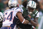 Chris Ivory #33 of the New York Jets is tackled by Dont'a Hightower #54 of the New England Patriots during overtime at MetLife Stadium on October 20, 2013 in East Rutherford, New Jersey. The Jets defeat the Patriots 30-27.