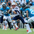 Tom Brady Photos - Tom Brady #12 of the New England Patriots scrambles for yardage during the game against the Jacksonville Jaguars at TIAA Bank Field on September 16, 2018 in Jacksonville, Florida. - New England Patriots vs. Jacksonville Jaguars