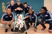 New England Revolution's (L to R) Charlie Davies, Brad Knighton, Kelyn Rowe, Andrew Farrell, and London Woodberry take a picture with Lucas and Dad at Boston Children's Hospital April 28, 2015 in Boston, Massachusetts.