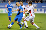 Marco Di Vaio #9 of the Montreal Impact moves the ball past A.J. Soares #5 of the New England Revolution during the MLS match at the Saputo Stadium on July 18, 2012 in Montreal, Quebec, Canada.  The Impact defeated the Revolution 2-1.