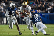 Tyler Murphy #2 of the Boston College Eagles runs between Marcus Allen #2 and Nyeem Wartman #5 of the Penn State Nittany Lions in the fourth quarter of the 2014 New Era Pinstripe Bowl at Yankee Stadium on December 27, 2014 in the Bronx borough of New York City.