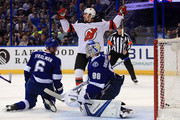 Michael Grabner #40 of the New Jersey Devils celebrates a goal by Nico Hischier #13 in the first period during Game Two of the Eastern Conference First Round against the Tampa Bay Lightning during the 2018 NHL Stanley Cup Playoffs at Amalie Arena on April 14, 2018 in Tampa, Florida.