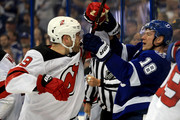 Ondrej Palat #18 of the Tampa Bay Lightning and Taylor Hall #9 of the New Jersey Devils fight during Game Two of the Eastern Conference First Round  during the 2018 NHL Stanley Cup Playoffs at Amalie Arena on April 14, 2018 in Tampa, Florida.