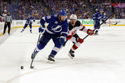 J.T. Miller #10 of the Tampa Bay Lightning fights off the check of Marcus Johansson #90 of the New Jersey Devils in the second period of Game Five of the Eastern Conference First Round during the 2018 NHL Stanley Cup Playoffs at Amalie Arena on April 21, 2018 in Tampa, Florida. (Photo by Mike Carlson/Getty Images) *** Local Caption *** Marcus Johansson;J.T. Miller