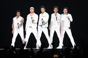 Danny Wood, Donnie Wahlberg, Jordan Knight, Joey McIntyre and Jonathan Knight of the musical group New Kids On The Block perform at Bridgestone Arena on May 09, 2019 in Nashville, Tennessee.