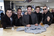 """Jordan Knight, Danny Mack, Jonathan Knight, Joey McIntyre and Donnie Whalberg of New Kids On The Block visit """"Extra"""" at The Levi's Store Times Square on March 08, 2019 in New York City."""