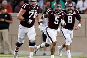 Trayveon Williams #5 of the Texas A&M Aggies celebrates with Trevor Knight #2 and Colton Prater #76 after scoring in the first quarter against the New Mexico State Aggies at Kyle Field on October 29, 2016 in College Station, Texas.