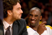 Kobe Bryant #24 of the Los Angeles Lakers jokes on the bench with injured teammate Pau Gasol #16 in the game with the New Orleans Hornets on November 8, 2009 at Staples Center in Los Angeles, California. The Lakers won 104-88.  NOTE TO USER: User expressly acknowledges and agrees that, by downloading and/or using this Photograph, user is consenting to the terms and conditions of the Getty Images License Agreement.