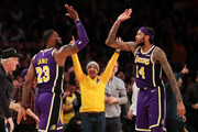 LeBron James #23 of the Los Angeles Lakers celebrates with Brandon Ingram #14 after making a three-pointer against Jrue Holiday #11 of the New Orleans Pelicans during the second half at Staples Center on February 27, 2019 in Los Angeles, California. NOTE TO USER: User expressly acknowledges and agrees that, by downloading and or using this photograph, User is consenting to the terms and conditions of the Getty Images License Agreement.
