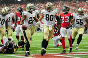 Mark Ingram #22 celebrates a touchdown with Jimmy Graham #80 of the New Orleans Saints in the second half against the Atlanta Falcons at the Georgia Dome on September 7, 2014 in Atlanta, Georgia. The Falcons won 37-34.