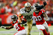 Jimmy Graham #80 of the New Orleans Saints is tackled by Desmond Trufant #21 of the Atlanta Falcons in the first half at the Georgia Dome on September 7, 2014 in Atlanta, Georgia. The Atlanta Falcons won 37-34.
