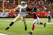 Jimmy Graham #80 of the New Orleans Saints is tackleds by Dwight Lowery #20 of the Atlanta Falcons in the first half against the New Orleans Saints at the Georgia Dome on September 7, 2014 in Atlanta, Georgia. The Atlanta Falcons won 37-34.