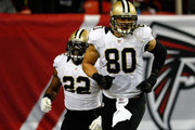 Tight end Jimmy Graham #80 of the New Orleans Saints celebrates a touchdown in the second quarter against the Atlanta Falcons during a game at the Georgia Dome on November 21, 2013 in Atlanta, Georgia.
