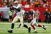 Jimmy Graham #80 of the New Orleans Saints makes a catch in the first half against the Atlanta Falcons at the Georgia Dome on September 7, 2014 in Atlanta, Georgia. The Atlanta Falcons won 37-34.