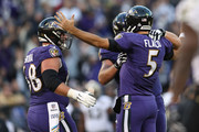 Quarterback Joe Flacco #5 of the Baltimore Ravens celebrates with center Matt Skura #68 after throwing a touchdown in the third quarter against the New Orleans Saints at M&T Bank Stadium on October 21, 2018 in Baltimore, Maryland.