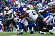 Tyrod Taylor #5 of the Buffalo Bills runs with the ball as Alex Okafor #57 of the New Orleans Saints attempts to tackle him during the fourth quarter on November 12, 2017 at New Era Field in Orchard Park, New York.