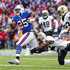Lesean Mccoy Photos - LeSean McCoy #25 of the Buffalo Bills runs the ball as Rafael Bush #25 of the New Orleans Saints and Marshon Lattimore #23 of the New Orleans Saints attempt to tackle him during the first quarter on November 12, 2017 at New Era Field in Orchard Park, New York. - New Orleans Saints vBuffalo Bills