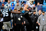 Jimmy Graham #80 of the New Orleans Saints makes a catch as Charles Johnson #95 of the Carolina Panthers looks on during their game at Bank of America Stadium on December 22, 2013 in Charlotte, North Carolina. The Panthers won 17-13.