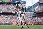Cornerback Joe Haden #23 of the Cleveland Browns puts pressure on tight end Jimmy Graham #80 of the New Orleans Saints as Graham catches a touchdown pass during the first half at FirstEnergy Stadium on September 14, 2014 in Cleveland, Ohio.