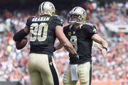 Tight end Jimmy Graham #80 celebrates with quarterback Drew Brees #9 of the New Orleans Saints after the two connected for a touchdown pass during the first half against the Cleveland Browns at FirstEnergy Stadium on September 14, 2014 in Cleveland, Ohio.