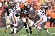 Jimmy Graham #80 of the New Orleans Saints tries to break through the defense of Justin Gilbert #21 and Tashaun Gipson #39 of the Cleveland Browns during the second quarter at FirstEnergy Stadium on September 14, 2014 in Cleveland, Ohio.