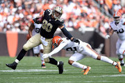 Jimmy Graham #80 of the New Orleans Saints avoids a tackle by Buster Skrine #22 of the Cleveland Browns during the second quarter at FirstEnergy Stadium on September 14, 2014 in Cleveland, Ohio.
