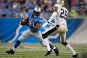 Reggie Bush #21 of the Detroit Lions rushes against Keenan Lewis #28 of the New Orleans Saints in the second quarter at Ford Field on October 19, 2014 in Detroit, Michigan.