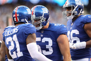 Connor Barwin #53 and Landon Collins #21 of the New York Giants celebrate after Collins broke up a pass in the end zone against the New Orleans Saints during the  at MetLife Stadium on September 30, 2018 in East Rutherford, New Jersey.